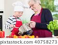 Granny cooking together with her grandson 40758273