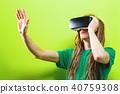 Young man using virtual reality headset 40759308