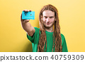 Happy man holding a retro cassette tape 40759309