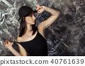 beautiful model in military jacket posing 40761639