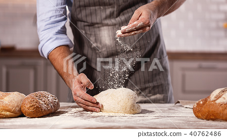 hands of baker's male knead dough. 40762486