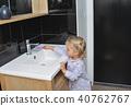 Little girl brushing teeth in the bath 40762767