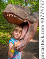 Little girls head in the mouth of a dinosaur 40774737