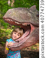 Little girls head in the mouth of a dinosaur 40774739