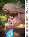 Little girls head in the mouth of a dinosaur 40774740
