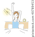 Woman stretching on a bed 40789453
