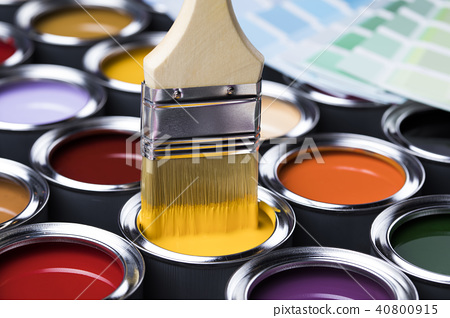 Paint brush, tin can and color guide samples. 40800915