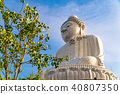 Low angle view of white marble big Buddha statue 40807350