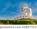 Low angle view of white marble big Buddha statue 40807353