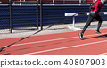 Runner pulling sled with weights on a track 40807903