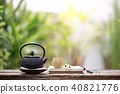 Old black tea pot with brown cup  40821776