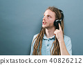 Man with headphones on a solid background 40826212
