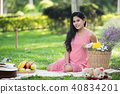 portrait of pregnant women on green background 40834201