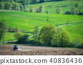 Tractor plowing field and beautiful landscape, France 40836436