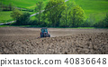 Tractor plowing field and beautiful landscape, France 40836648