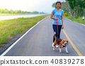 Girl outdoors on road with her dog 40839278