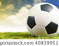 Soccer ball on green grass background 40839951