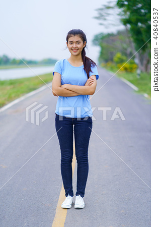 Portrait of beautiful girl in blue t-shirt and jeans standing in 40840537