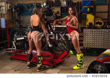 Sexy girls repairing motorcycle 40850608