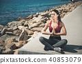 Smiling girl doing yoga exercise 40853079