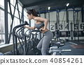 Young woman exercises in gym healthy lifestyle cardio workout on bike 40854261