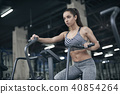 Young woman exercises in gym healthy lifestyle cardio workout on bike 40854264
