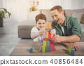 Glad dad and son building toy house 40856484