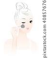 畫臉頰的女人。化妝。 40857676