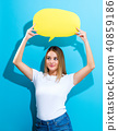 Young woman holding a speech bubble 40859186
