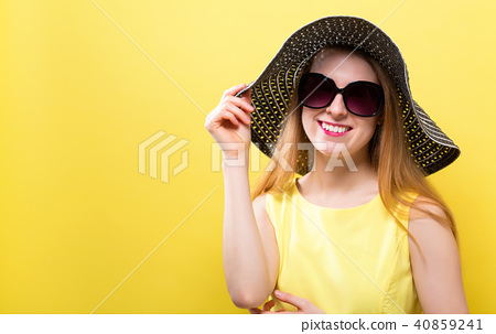 Happy young woman wearing a hat 40859241