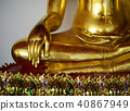 Close up view of the low hand golden buddha statue 40867949