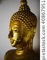 A close up shot of a beautiful golden buddha statu 40867951