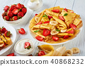 thin pancakes or crepes with fruits 40868232
