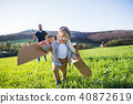 Happy toddler boy playing outside with father in spring nature. 40872619