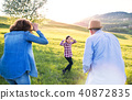 A small girl with her senior grandparents having fun outside in nature. 40872835