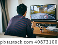 A young Japanese men engrossing in video games 40873100