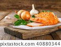 Pork lard with greens on a wooden table. 40880344