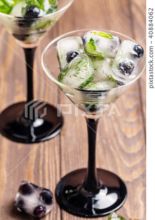 Ice cubes with dill, estragon and blueberry  40884062