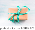 Gift box with green ribbon pastel background 40889321