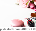 Make up products and tools with pink roses flower 40889339