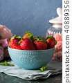 Strawberries in bowl with heart and meringues 40889356