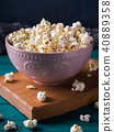Popcorn in pink bowl on dark background 40889358
