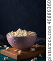 Popcorn in pink bowl on dark background 40889360