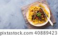 Fusilli pasta with eggplant sauce 40889423