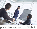 Businesspeople at office working together woman asking question collegue 40890630