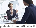Businesspeople at office working together sitting discussing project concentrated close-up 40890631