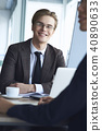 Businesspeople at office working together sitting man looking camera friendly 40890633