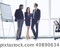Businesspeople at office working together standing woman taking notes cheerful 40890634