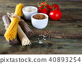 bunch of Italian spaghetti, noodles soba and sommel, bowls with buckwheat and rice with tomato on an 40893254