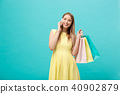 Portrait of happy fashion caucasian woman with shopping bags calling on mobile phone. Isolated on 40902879